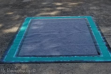 Spray Painted Outdoor Rug for Camper or RV - My Repurposed