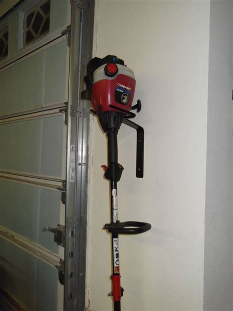 Line trimmer / Weed eater wall hanger storage by