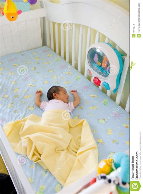 Small Baby In Big Crib Stock Images - Image: 4974934